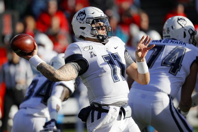 Connecticut quarterback Jack Zergiotis passes during the first half of an NCAA college football game against Cincinnati, Saturday, Nov. 9, 2019, in Cincinnati. (AP Photo/John Minchillo)