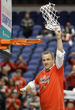 Louisville head coach Jeff Walz celebrates after cutting down the net after their win over Notre Dame in an NCAA college basketball game in the championship of the women's Atlantic Coast Conference tournament in Greensboro, N.C., Sunday, March 4, 2018. (AP Photo/Chuck Burton)