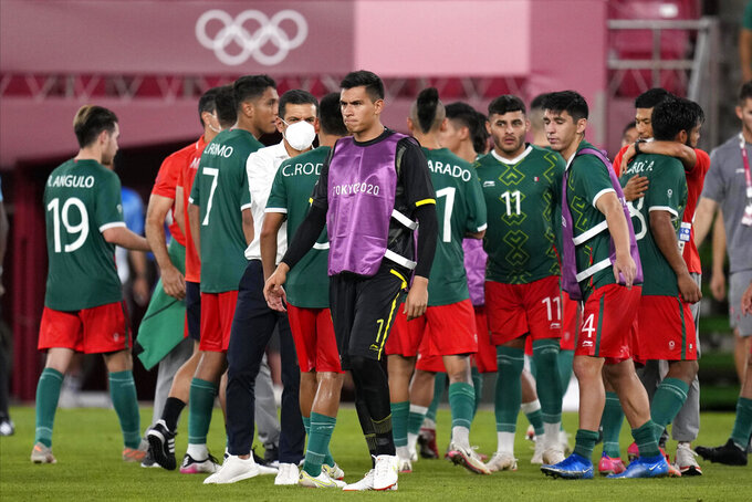 Mexico's players react after defeated by Brazil in a penalty shootout in a men's soccer semifinal match at the 2020 Summer Olympics, Tuesday, Aug. 3, 2021, in Kashima, Japan. (AP Photo/Andre Penner)