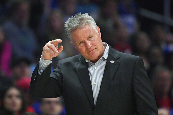 FILE - In this March 1, 2020, file photo, Philadelphia 76ers head coach Brett Brown gestures during the first half of an NBA basketball game against the Los Angeles Clippers in Los Angeles. Brown's job status is a hot topic around the NBA and a daily debate in Philly. (AP Photo/Mark J. Terrill, File)