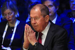 Russian Foreign Minister Sergey Lavrov gestures as he arrives at the Paris Peace Forum Tuesday, Nov. 12, 2019 in Paris. (AP Photo/Michel Euler, Pool)