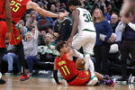 Boston Celtics guard Marcus Smart (36) steps over Atlanta Hawks guard Trae Young (11) to retrieve the ball, causing a scuffle in the last seconds of an NBA basketball game Friday, Jan. 3, 2020, in Boston. The Celtics won 109-106. (AP Photo/Elise Amendola)