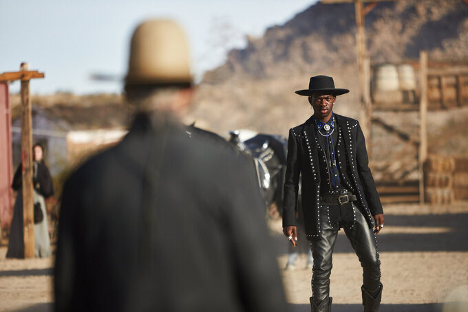 """This undated photo provided by Doritos shows Lil Nas X, right, and Sam Elliott in a scene from the company's 2020 Super Bowl NFL football spot. The snack chip is betting people will connect with """"Old Town Road,"""" the smash hit of the summer by Lil Nas X. (Doritos via AP)"""