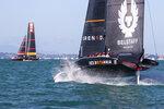 Britain's INEOS Team UK, right, trails Italy's Luna Rossa in race seven of the Prada Cup on Auckland's Waitemata Harbour, New Zealand, Sunday, Feb.21, 2021. (Brett Phibbs/NZ Herald via AP)