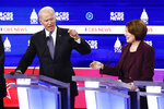 Democratic presidential candidates, former Vice President Joe Biden, left, and Sen. Amy Klobuchar, D-Minn., participate in a Democratic presidential primary debate at the Gaillard Center, Tuesday, Feb. 25, 2020, in Charleston, S.C., co-hosted by CBS News and the Congressional Black Caucus Institute. (AP Photo/Patrick Semansky)