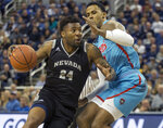 Nevada forward Jordan Caroline (24) drives past New Mexico guard Vance Jackson (2) in the first half of an NCAA college basketball game in Reno, Nev., Saturday, Feb. 9, 2019. (AP Photo/Tom R. Smedes)