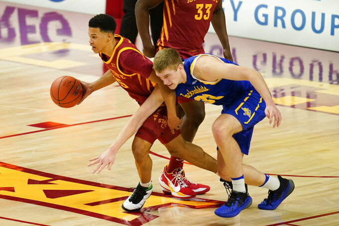 Iowa State guard Rasir Bolton, left, drives up court ahead of South Dakota State forward Matt Dentlinger during the first half of an NCAA college basketball game, Wednesday, Dec. 2, 2020, in Ames, Iowa. (AP Photo/Charlie Neibergall)