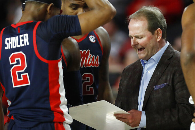 Mississippi coach Kermit Davis speaks with his team during a timeout in an NCAA college basketball game against Georgia  in Athens, Ga., on Saturday, Feb. 9, 2019. (Joshua L. Jones/Athens Banner-Herald via AP)