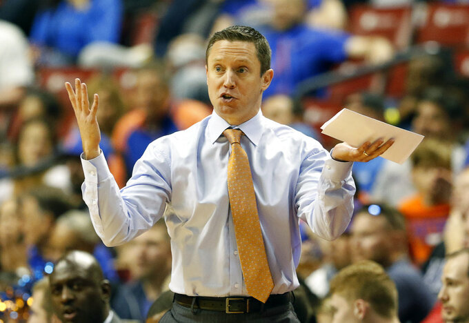 FILE - In this Dec. 22, 2018, file photo, Florida head coach Mike White reacts in the first half of play against Florida Gulf Coast in an NCAA college basketball game, part of the Orange Bowl Classic tournament, in Sunrise, Fla. Florida coach Mike White has three guys he can count on to bring energy and effort every day. Problem is two of them are freshmen. Although that might bode well for the future of the program, it's not how the Gators were expected to play in White's fourth season. So the coach is scratching his head and searching for answers as Florida (8-5, 0-1 Southeastern Conference) prepares to play at Arkansas (10-3, 1-0) on Wednesday night, Jan. 9, 2019. (AP Photo/Joe Skipper, File)