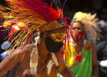 South Africans celebrate Heritage Day with song and dance at the Nelson Mandela Square in Johannesburg, Thursday, Sept. 24, 2020. (AP Photo/Denis Farrell)