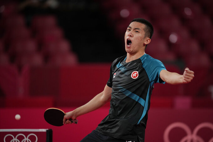 Hong Kong's Lam Siu-hang celebrates after winning the table tennis men's singles second round match against India's Sathiyan Gnanasekaran at the 2020 Summer Olympics, Sunday, July 25, 2021, in Tokyo. (AP Photo/Kin Cheung)