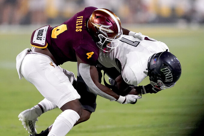 UNLV wide receiver Kyle Williams (1) is tackled by Arizona State defensive back Evan Fields (4) during the first half of an NCAA college football game, Saturday, Sept. 11, 2021, in Tempe, Ariz. (AP Photo/Matt York)
