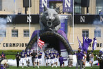 The Northwestern team runs onto the field before an NCAA college football game against Indiana State in Evanston, Ill, Saturday, Sept. 11, 2021. (AP Photo/Matt Marton)