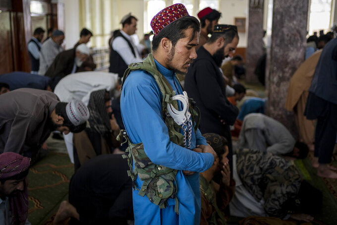 A Taliban fighter prays inside a mosque during Friday prayers in Kabul, Afghanistan, Friday, Sept. 17, 2021. (AP Photo/Bernat Armangue)