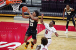 Purdue guard Jaden Ivey (23) goes up for a layup next to Rutgers guard Montez Mathis (10) during the second half of an NCAA college basketball game Tuesday, Dec. 29, 2020, in Piscataway, N.J. (AP Photo/Kathy Willens)