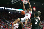 Arizona forward Ira Lee (11) dunks over Colorado guard D'Shawn Schwartz (5) and Daylen Kountz during the second half of an NCAA college basketball game Saturday, Jan. 18, 2020, in Tucson, Ariz. Arizona won 75-54. (AP Photo/Rick Scuteri)