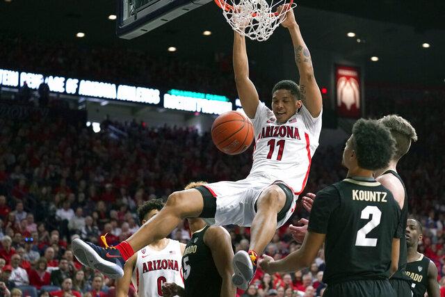Arizona forward Ira Lee (11) dunks over Colorado guard D'Shawn Schwartz (5) and Daylen Kountz during the second half of an NCAA college basketball game Saturday, Jan. 18, 2020, in Tucson, Ariz. Arizona won 75-54. (AP Photo/Rick Scuteri)