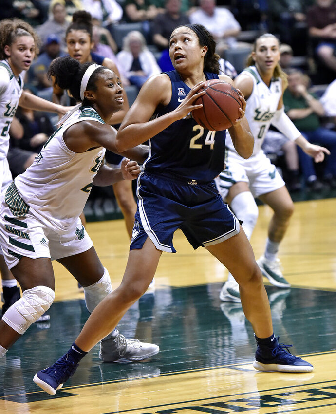 South Florida's Shae Leverett, left, defends against Connecticut's Napheesa Collier (24) during the second half of an NCAA basketball game Monday, March 4, 2019, in Tampa, Fla. (AP Photo/Steve Nesius)
