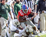 Mississippi running back Jerrion Ealy (9) is tackled by Southeastern Louisiana defensive back Tre' Spann (25) and Southeastern Louisiana linebacker Alexis Ramos (30) during the first half of an NCAA college football game, Saturday, Sept. 14, 2019 in Oxford, Miss. (Bruce Newman/The Oxford Eagle via AP)