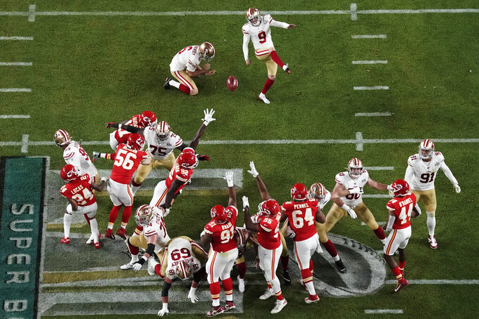 San Francisco 49ers' Robbie Gould (9) kicks a field goal as Mitch Wishnowsky holds, during the second half of the NFL Super Bowl 54 football game against the Kansas City Chiefs', Sunday, Feb. 2, 2020, in Miami Gardens, Fla. (AP Photo/Morry Gash)