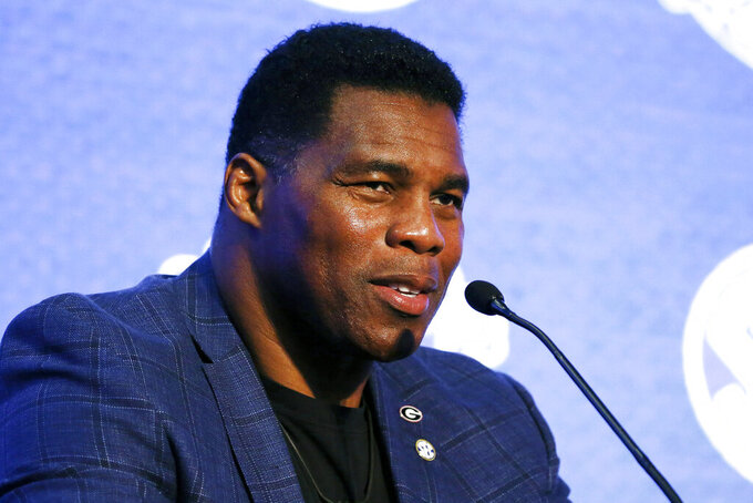 FILE - In this July 16, 2019, file photo, Herschel Walker talks about 150 years of college football during the NCAA college football Southeastern Conference Media Day in Hoover, Ala. Walker appears to have a coveted political profile for a potential Senate candidate in Georgia. (AP Photo/Butch Dill, File)