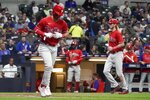 Philadelphia Phillies' Bryce Harper heads to first after walking with bases loaded during the third inning of a baseball game against the Milwaukee Brewers Wednesday, Sept. 8, 2021, in Milwaukee. (AP Photo/Morry Gash)