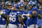 New York Giants wide receiver Darius Slayton (86) celebrates with quarterback Eli Manning (10) and other teammates after scoring a touchdown against the Miami Dolphins during the third quarter of an NFL football game, Sunday, Dec. 15, 2019, in East Rutherford, N.J. (AP Photo/Seth Wenig)