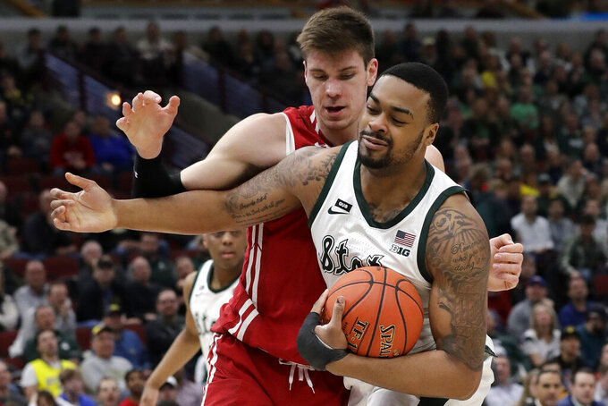 Michigan State's Nick Ward, right, battles for a loose ball against Wisconsin's Ethan Happ during the first half of an NCAA college basketball game in the semifinals of the Big Ten Conference tournament, Saturday, March 16, 2019, in Chicago. (AP Photo/Nam Y. Huh)