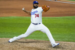 Los Angeles Dodgers relief pitcher Kenley Jansen throws against the Atlanta Braves during the ninth inning in Game 6 of a baseball National League Championship Series Saturday, Oct. 17, 2020, in Arlington, Texas. (AP Photo/Tony Gutierrez)