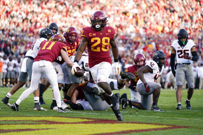 Iowa State running back Breece Hall (28) scores on a 4-yard touchdown run during the second half of an NCAA college football game against Oklahoma State, Saturday, Oct. 23, 2021, in Ames, Iowa. Iowa State won 24-21. (AP Photo/Charlie Neibergall)