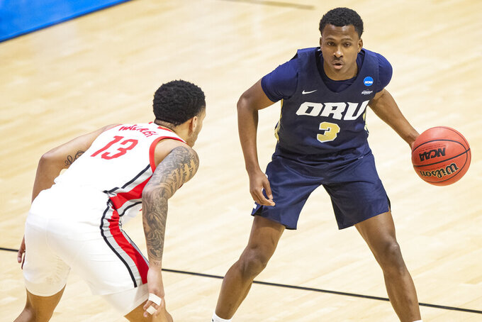 Oral Roberts' Max Abmas (3) drives against Ohio State's CJ Walker (13) during the first half of a first round game in the NCAA men's college basketball tournament, Friday, March 19, 2021, at Mackey Arena in West Lafayette, Ind. (AP Photo/Robert Franklin)