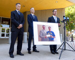 Newport Beach Police Sgt, Ryan Peters, left, Senior Deputy District Attorney Matt Murphy, second from left, and District Attorney Todd Spitzer speak to the media following the verdict for Hossein Nayeri in Newport Beach, Calif., Friday, Aug. 16, 2019. Peters was the lead detective in the case. Spitzer is holding a photo of himself presenting a $100,000 check to Matthew Hay-Chapman after Hay-Chapman spotted Nayeri in San Francisco after breaking out of jail. Nayeri who previously escaped from jail and was on the run for a week was convicted Friday of kidnapping and torturing a marijuana dispensary owner who he mistakenly believed had buried large sums of money in the desert. (Paul Bersebach/The Orange County Register via AP)