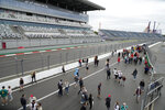 Spectators enjoy a pre-race track walk at the Sochi Autodrom circuit, in Sochi, Russia, Thursday, Sept. 23, 2021. The Russian Formula One Grand Prix will be held on Sunday. (AP Photo/Sergei Grits)