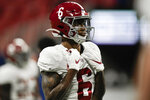 Alabama wide receiver DeVonta Smith (6) warms up before the first half of the Southeastern Conference championship NCAA college football game against Florida, Saturday, Dec. 19, 2020, in Atlanta. Heisman Trophy finalists Mac Jones and DeVonta Smith have been selected to The Associated Press All-America team, Monday, Dec. 28, 2020, leading a contingent of five Alabama players on the first-team offense. (AP Photo/Brynn Anderson)