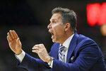 Saint Joseph's head coach Billy Lange leads his team in the first half of an NCAA college basketball game against Connecticut Wednesday, Nov. 13, 2019, in Storrs, Conn. (AP Photo/Stephen Dunn)