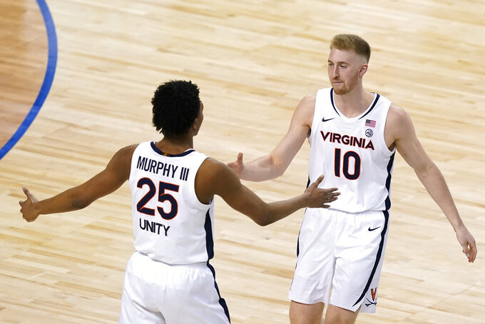 Virginia forward Sam Hauser (10) and Virginia guard Trey Murphy III (25) celebrate a basket during the second half of an NCAA college basketball game in the quarterfinal round of the Atlantic Coast Conference tournament in Greensboro, N.C., Thursday, March 11, 2021. (AP Photo/Gerry Broome)