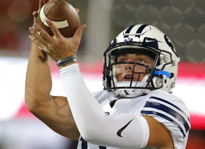 FILE - In this Sept. 1, 2018 file photo BYU linebacker Sione Takitaki (16) handles the ball in the first half during an NCAA college football game against Arizona in Tucson, Ariz. BYU will be looking to close out a roller coaster season when it faces Western Michigan in the Famous Idaho Potato Bowl in Boise on Friday, Dec. 21, 2018. (AP Photo/Rick Scuteri, file)