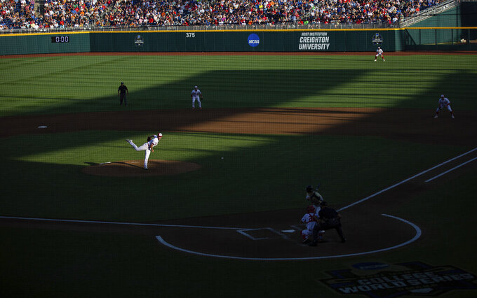 North Carolina State starting pitcher Sam Highfill throws against Vanderbilt's Parker Noland in the fifth inning during a baseball game in the College World Series, Monday, June 21, 2021, at TD Ameritrade Park in Omaha, Neb. (AP Photo/Rebecca S. Gratz)
