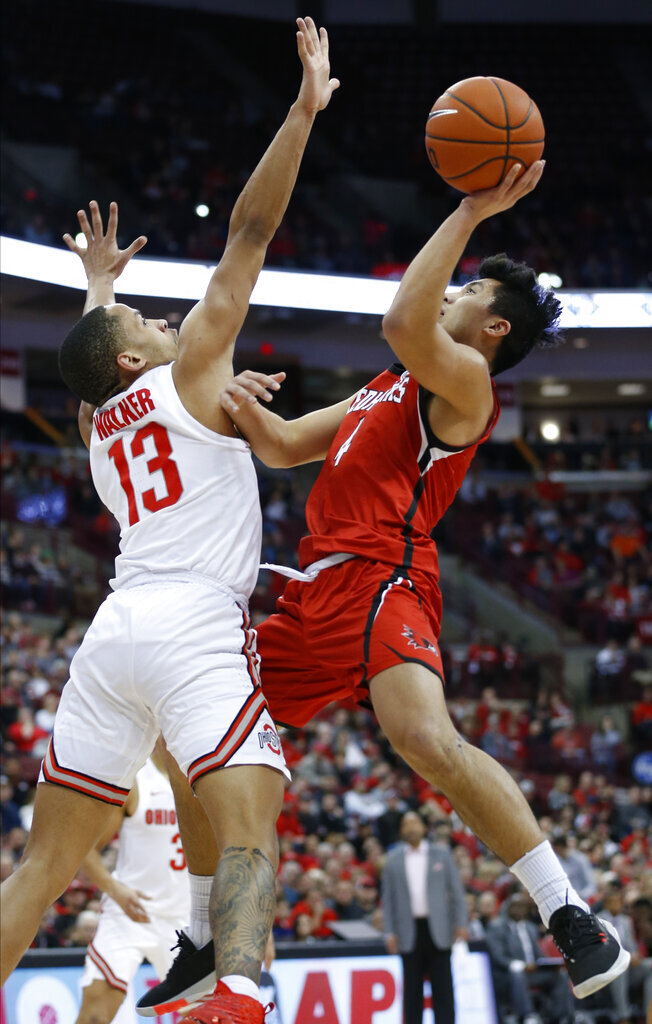 Southeast Missouri State's Oscar Kao, right, shoots over Ohio State's C.J. Walker during the first half of an NCAA college basketball game, Tuesday, Dec. 17, 2019, in Columbus, Ohio. (AP Photo/Jay LaPrete)