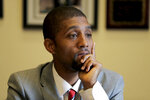 """Baltimore Council President Brandon Scott talks to The Associated Press about the late U.S. Rep. Elijah Cummings, D-Md., a day after the congressman died Friday, Oct. 18, 2019, in Baltimore. """"We grew up idolizing him. Before there was Barack Obama, here, we had Elijah Cummings,"""" Scott said.  (APPhoto/Julio Cortez)"""