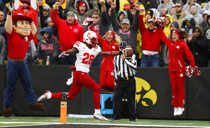 FILE - In this Nov. 23, 2018, file photo, Nebraska running back Maurice Washington celebrates after catching a 28-yard touchdown pass during the second half of an NCAA college football game against Iowa, in Iowa City, Iowa. Nebraska running back Maurice Washington has turned himself in to California authorities to face felony and misdemeanor charges related to his possession and distribution of a video of his former girlfriend allegedly being sexually assaulted by two other people in 2016. Deputy Michael Low of the Santa Clara County sheriff's office in San Jose said Washington surrendered about 7 a.m. PDT on Monday, March 11, 2019,  and bailed out. (AP Photo/Charlie Neibergall, File)