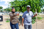 In this Friday, May 21, 2021, photo, provided by the California Reporting Project, Bakersfield residents Christina Crompton and Isaiah Crompton comment on the importance for African American voices to be heard, in Bakersfield, Calif. Better cultural training and increased diversity on police forces are two ways to decrease tension and mistrust between police and community members, say the Cromptons. (Anne Daugherty/California Reporting Project via AP)