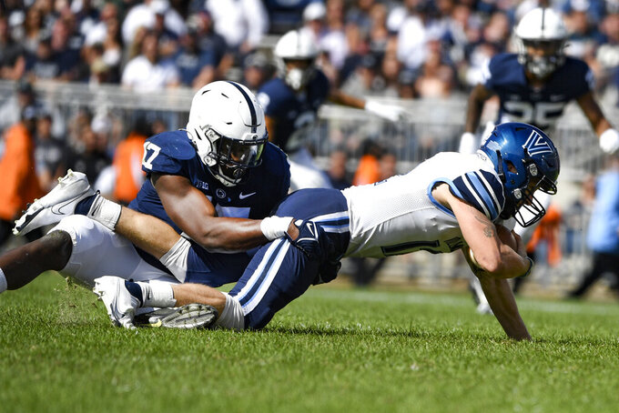 Penn State defensive end Arnold Ebiketie (17) sacks Villanova quarterback Daniel Smith, right, during an NCAA college football game in State College, Pa., on Saturday, Sept. 25, 2021. (AP Photo/Barry Reeger)