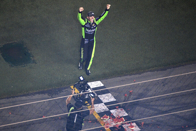 Ross Chastain celebrates after smashing a watermelon at the finish line following his win in the NASCAR Xfinity Series auto race at Daytona International Speedway, Saturday, July 6, 2019, in Daytona Beach, Fla. (AP Photo/Phelan M. Ebenhack)