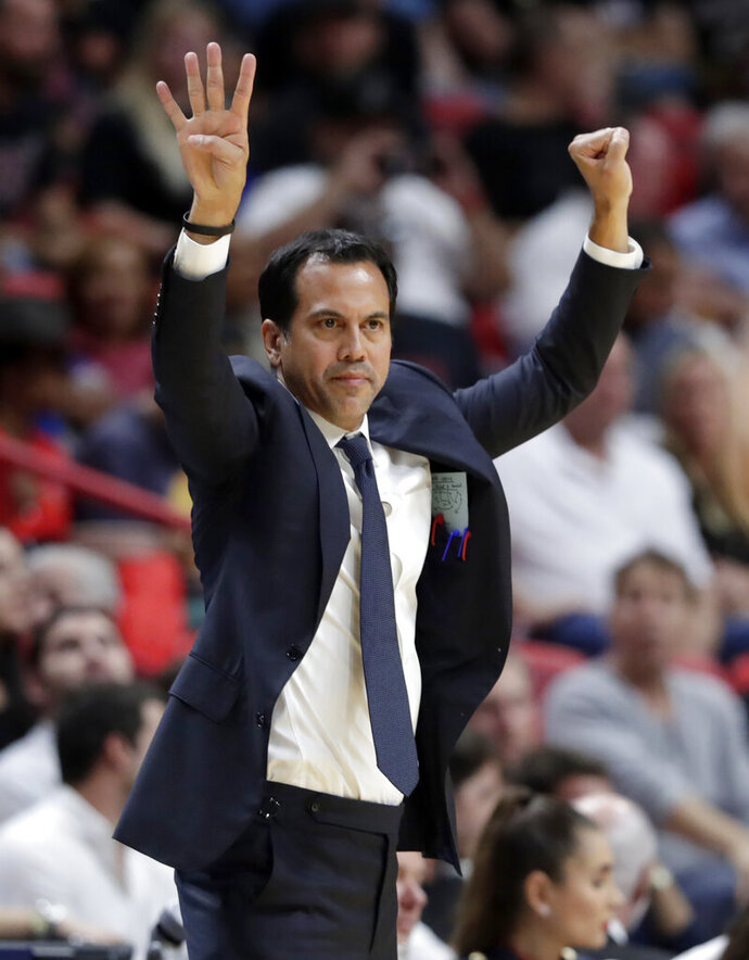 Miami Heat head coach Erik Spoelstra watches during the first half of the team's NBA basketball game against the Atlanta Hawks, Tuesday, Oct. 29, 2019, in Miami. The Heat won 112-97. (AP Photo/Lynne Sladky)