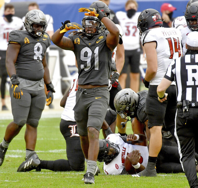 Pittsburgh defensive lineman Patrick Jones II celebrates after sacking Louisville quarterback Malik Cunningham in the third quarter during an NCAA college football game at Heinz Field, Saturday, Sept. 26, 2020, in Pittsburgh. (Matt Freed/Pittsburgh Post-Gazette via AP)