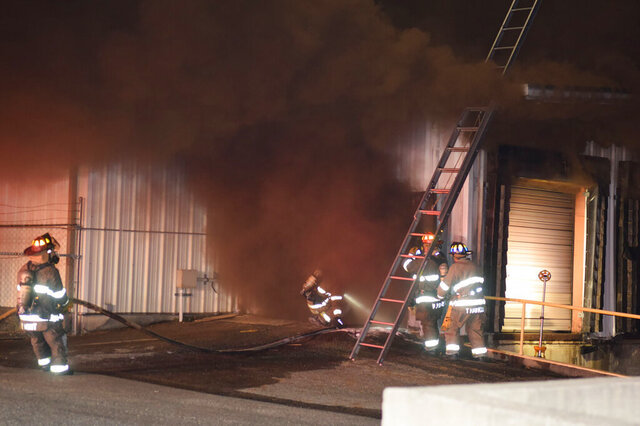 Tyler, Texas firefighters respond to a fire and explosion at the freezer buildings at Greenberg Smoked Turkeys Inc., in Tyler, Texas, Friday, Nov. 6, 2020. The company in eastern Texas that sells about 200,000 smoked turkeys every holiday season was forced to shut down after the fire and at least two explosions destroyed part of the facility. The company will halt production for the rest of 2020 after a mechanical failure that started a fire caused a freezer holding 87,000 turkeys to explode. (Zak Wellerman/Tyler Morning Telegraph via AP)