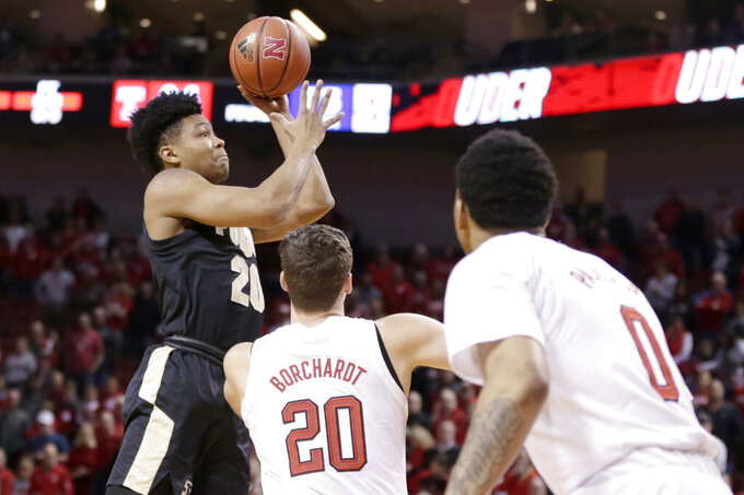 Purdue's Nojel Eastern (20) shoots as Nebraska's Tanner Borchardt (20) and James Palmer Jr. (0) watch, during the first half of an NCAA college basketball game in Lincoln, Neb., Saturday, Feb. 23, 2019. (AP Photo/Nati Harnik)