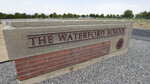 The Waterford School sign is shown Wednesday, Aug. 5, 2020, in Sandy, Utah. A lawsuit accuses an elite private school in Utah of mishandling a 2017 sexual assault allegation from a student with disabilities who endured bullying from classmates, including a reenactment of the rape during a school assembly. Administrators at Waterford School held a meeting with the rest of her class where they shared details of the off-campus allegations and would not help the 17-year-old girl enforce a protective order against her classmate, according to the lawsuit seeking $10 million in damages. (AP Photo/Rick Bowmer)