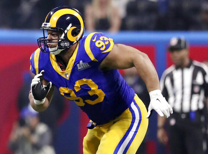 FILE - In this Feb. 3, 2019, file photo, Los Angeles Rams' Ndamukong Suh chases the action during NFL Super Bowl 53 football game against the New England Patriots in Atlanta. Suh, who helped the Rams make the Super Bowl last season, has agreed to terms with the Tampa Bay Buccaneers as a replacement for Gerald McCoy.  (AP Photo/Gregory Payan, File)